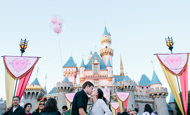 Disneyland wedding proposal in front of Sleeping Beauty Castle by Ohana Photographers