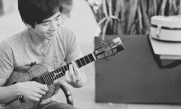 Jake Shimabukuro playing his ukulele in San Diego with Musubi Map creator Nino Camilo and David Baxter of Ohana Photographers